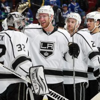 Jeff Carter (#77) congratulating goaltender Jonathan Quick (#32).