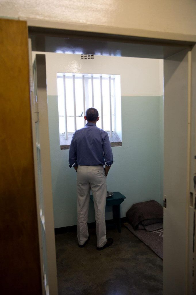 Image of President Obama in Nelson Mandela's prison cell on Robben Island via Pete Souza