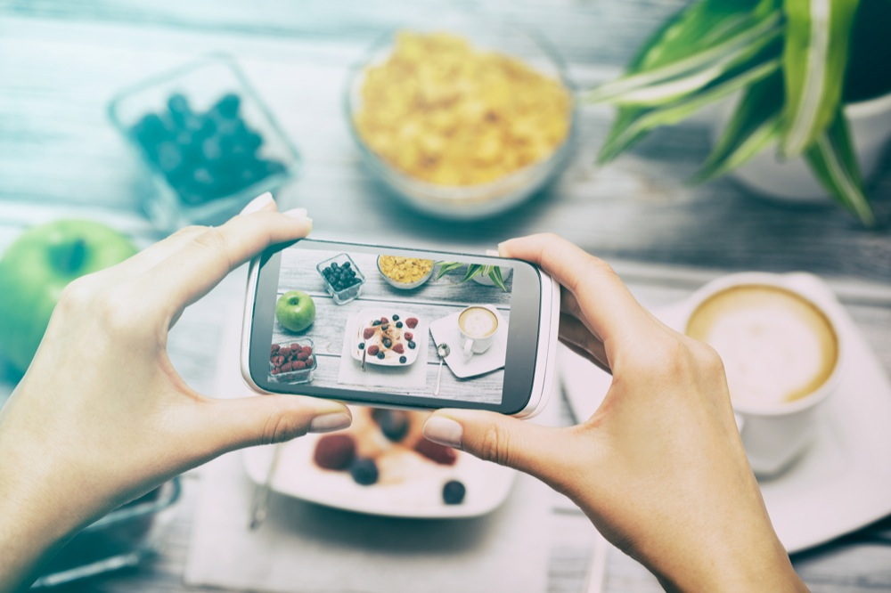Taking photo of food with smart phone.